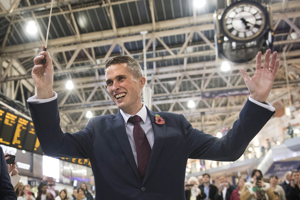Victoria Jones Press Association Photographer - November 2017  New Secretary of State for Defence Gavin Williamson conducts the Band of the Grenadier Guards at Waterloo Station in London on London Poppy Day during his first public appearance since his new appointment.
