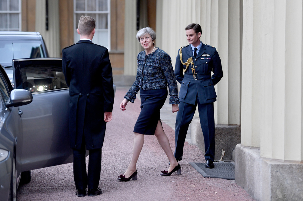 Victoria Jones Press Association Photographer - May 2017  Prime Minister Theresa May leaving Buckingham Palace, London, after an audience with Queen Elizabeth II to mark the dissolution of Parliament for the General Election.