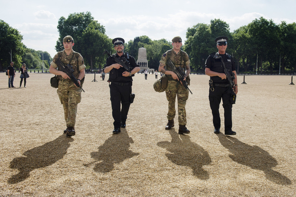 Victoria Jones Press Association Photographer - May 2017  Soldiers join police officers on Horse Guards Parade in Westminster, London, as armed troops have been deployed to guard key locations as the terrorism threatlevel is raised toimminent.