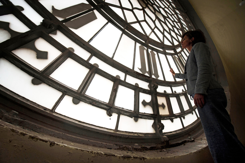 Victoria Jones Press Association Photographer - August 2017  A staff memberlooks at peeling paintwork and chipped masonry on the stairwell on the Elizabeth Tower, ahead of the bell ceasing to ring on Monday, at the Palace of Westminster, London.