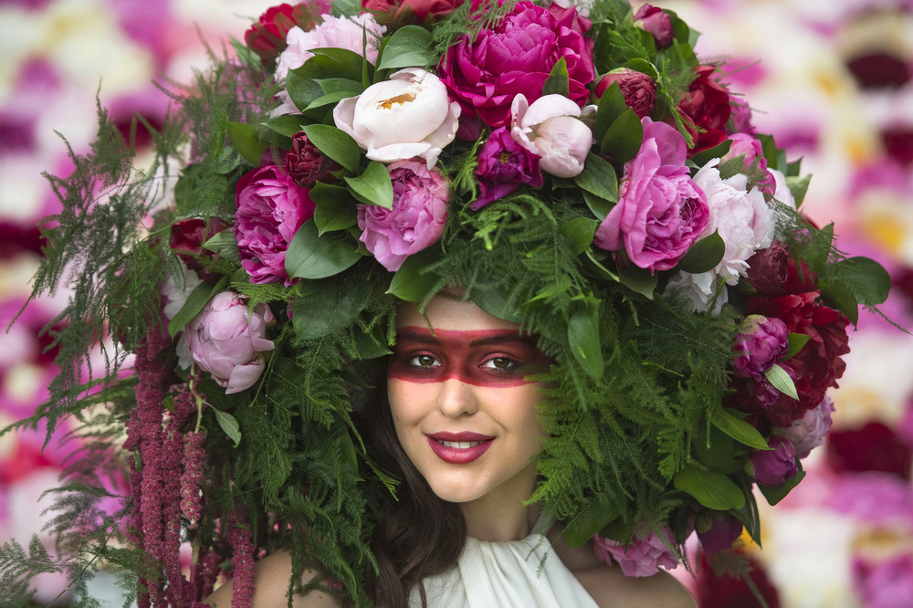 Victoria Jones Press Association Photographer - May 2017  A model wears a bespoke Peony Floral headdress on the Primrose Hall stand at the RHS Chelsea Flower Show in London.