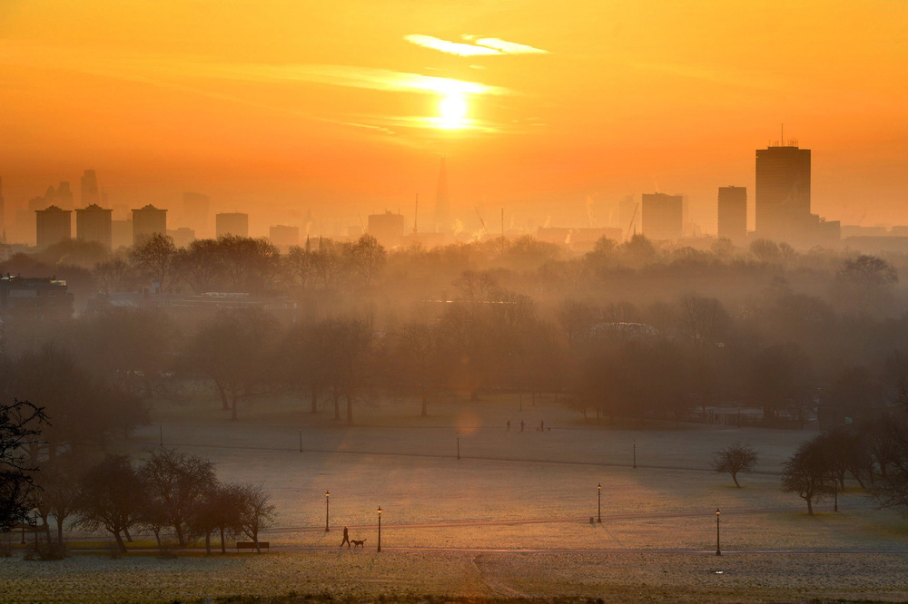 Victoria Jones Press Association Photographer - January 2017  A frosty start to the year on Primrose Hill as the sun rises over London.