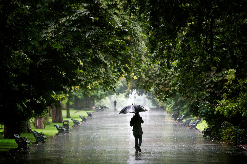 Victoria Jones Press Association Photographer - August 2017  A man walks through the rain in Regents Park, London, as unseasonal wet weather continues to hit the UK.
