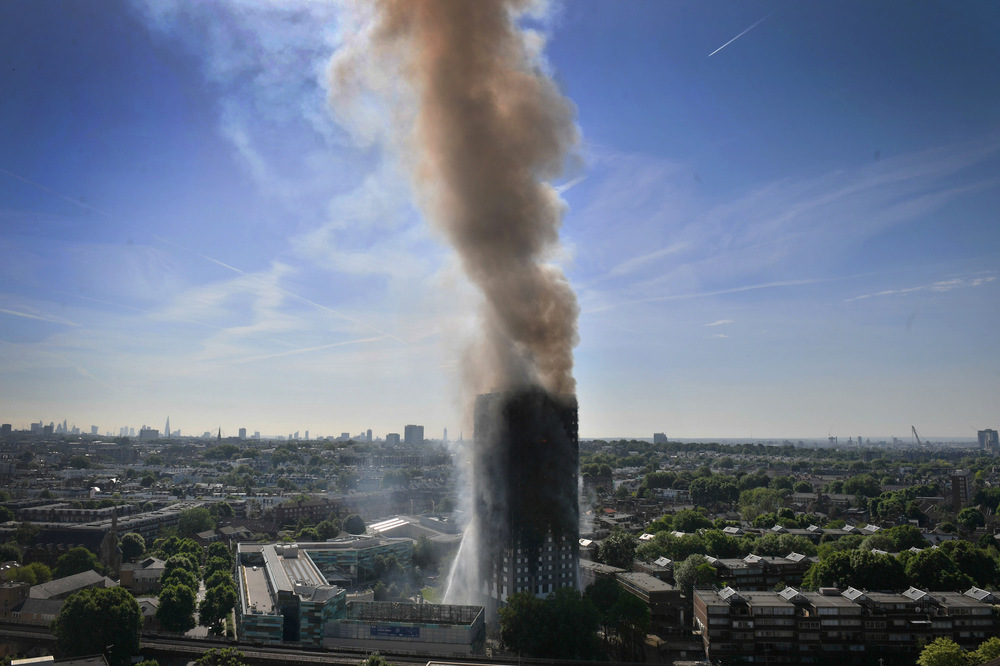 Victoria Jones Press Association Photographer - June 2017  Smoke billows from a fire that has engulfed the 24-storey Grenfell Tower in west London.