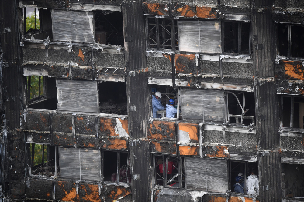 Victoria Jones Press Association Photographer - October 2017  Work commences to cover the ruin of Grenfell Tower, nearly four months since a fire inflicted the most costly tragedy in recent British history.