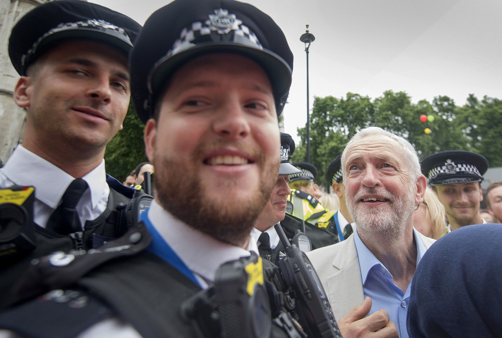 Victoria Jones Press Association Photographer - July 2017  Labour leader Jeremy Corbyn is mobbed by the crowd after addressing an anti-austerity rally in Parliament Square, London.