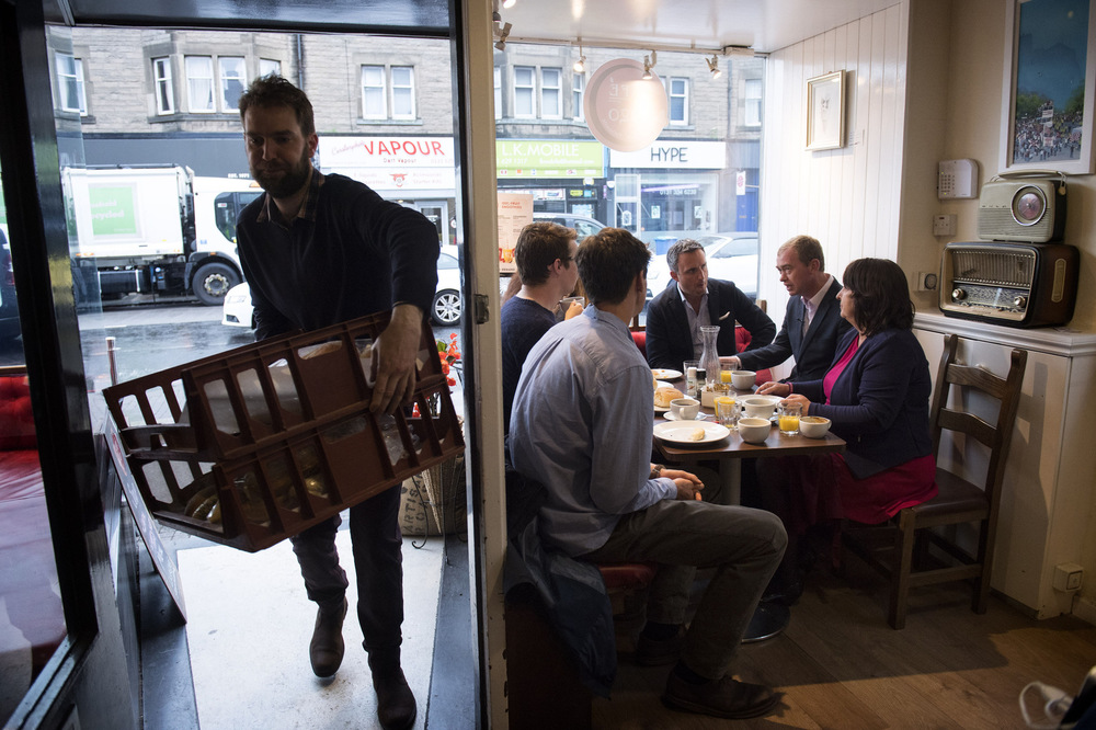 Victoria Jones Press Association Photographer - June 2017  Liberal Democrats leader Tim Farron talks with activists in a bakeryin Edinburghon the General Election campaign trail.