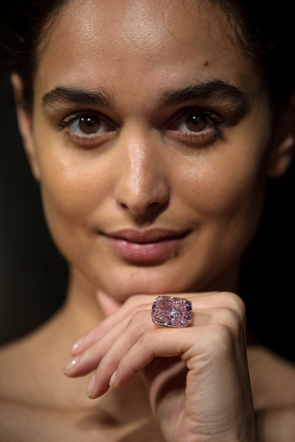 Victoria Jones Press Association Photographer - October 2017  A model wears The Raj Pink, the worlds largest known fancy intense pink diamond and valued at $20-30 million,before it is offered at auction at Sothebys.