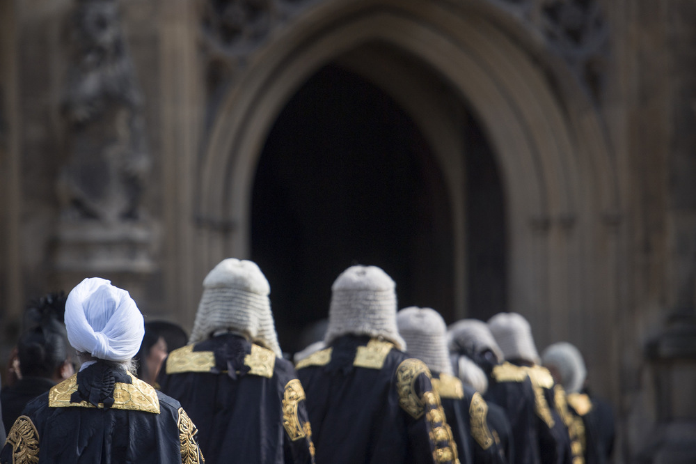 Victoria Jones Press Association Photographer - October 2017  Members of the judiciary walk from Westminster Abbey to the Palace of Westminster in London following the annual Judges Service.