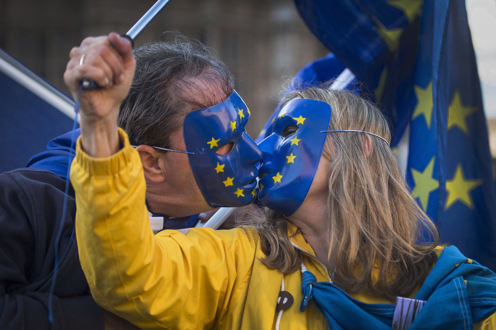 Victoria Jones Press Association Photographer - September 2017  Pro-European Union and anti-Brexit demonstrators kiss during a protest outside the Houses of Parliament in central London.