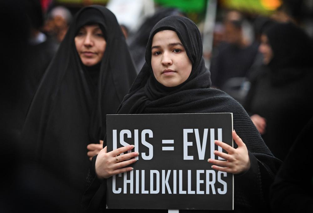 Victoria Jones Press Association Photographer - October 2017  Demonstrators march towards Trafalgar Square in central London, to mark the Islamic event of Ashura.