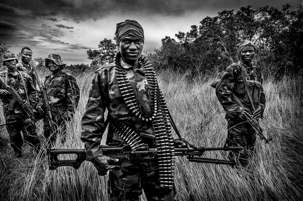 John T. Pedersen Photography -   The hunt for Joseph Kony   Soldiers from UPDF (The Uganda Peoples Defence Force) hunts LRA (Lord Resistance Army) deep into the jungle of region Ottokoto in Central African Republic.   War criminal Joseph Kony is the leader of this guerrilla group that formerly operated in Uganda.   His rebels is notorious for abducting thousands of children to use as soldiers or sex slaves. From 1987 to 2006, the armed group abducted more than 20,000 children to use as soldiers, servants or sex slaves, according to Unicef. The group's violence has displaced more than 2.5 million people.   Kony proclaims himself the spokesperson of God.