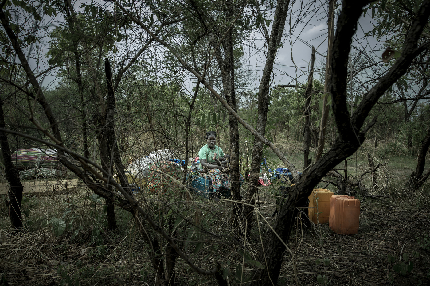 John T. Pedersen Photography - A woman and her children are waiting to be given the place and tent for their permanent stay.