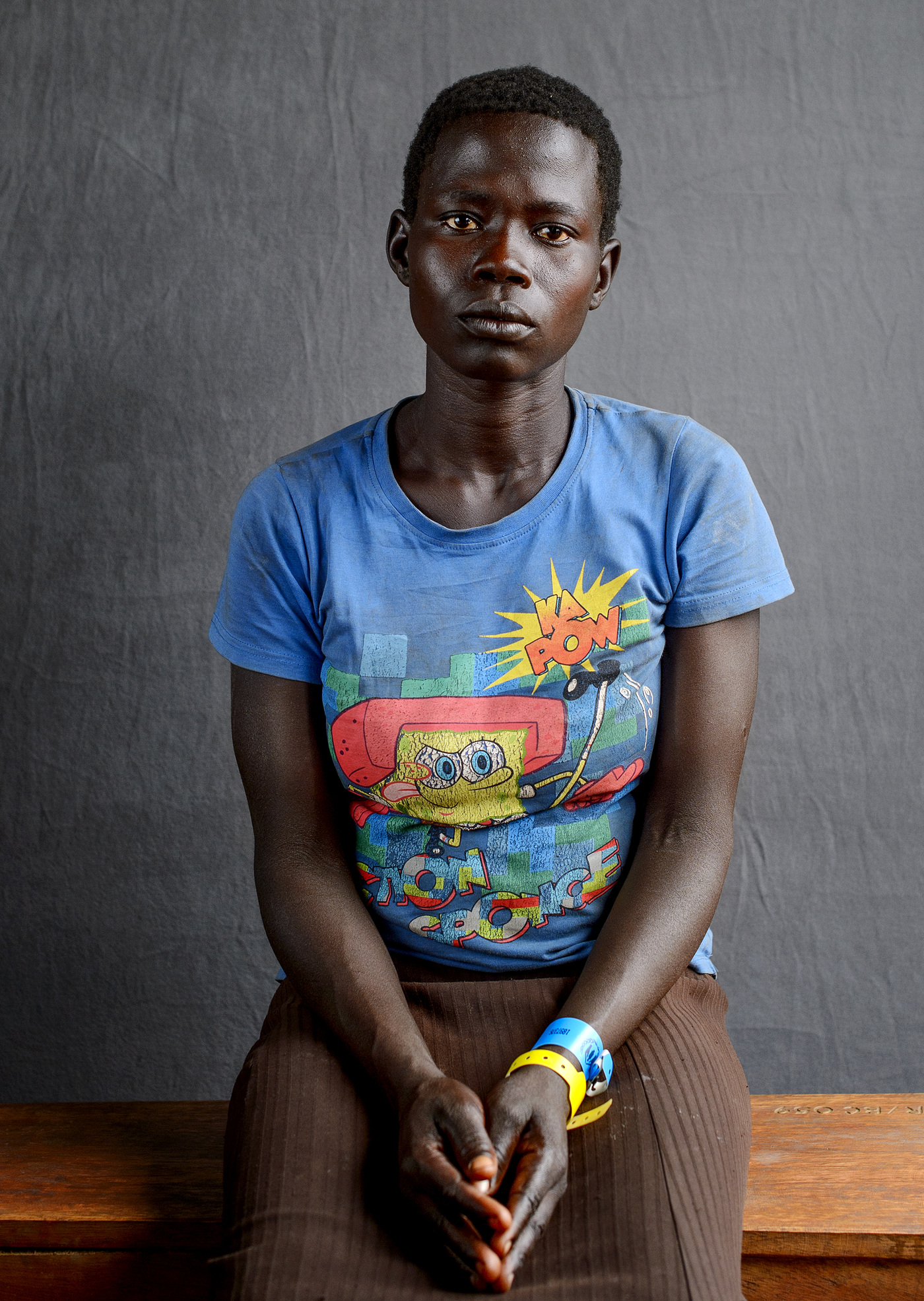 John T. Pedersen Photography - Alice Boro (36)   I escaped with my husband from our village. Before we got to the border, my husband decided to go back to bring more food.   There he was shot by the government soldiers    Im sick with heart problems and hope I can get medical help here in Uganda.   Alice walked for two weeks with her five children from the village of Wugi.