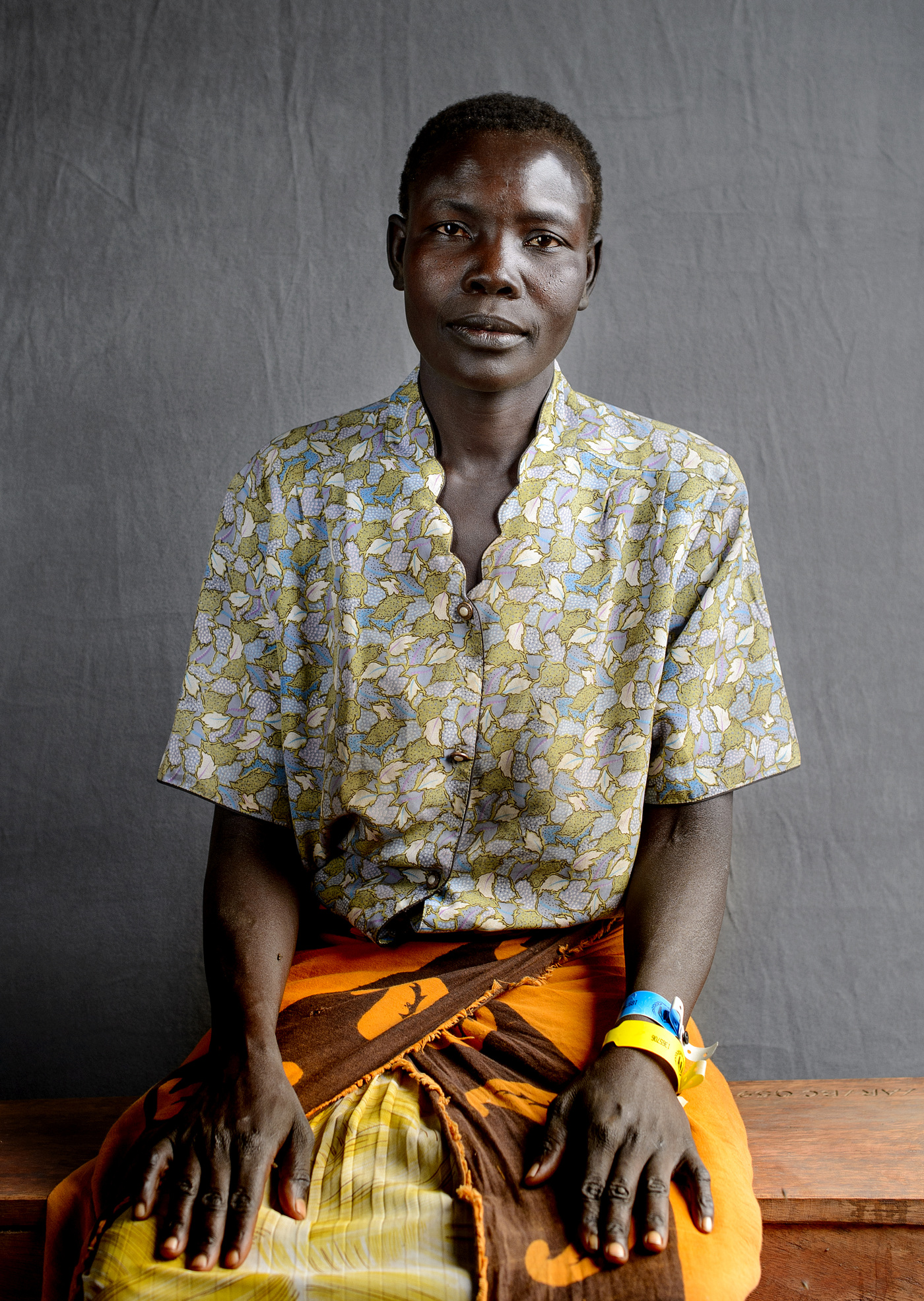 John T. Pedersen Photography - Katerina Kadi (45)   My husband was killed by the government soldiers when he was going to bring some food from our garden. He was accused of being a rebel, something he failed to disprove. They cut over his throat   My hope and desire is to settle with my children here in Uganda.     Katerina walked eigth days with her four children from the village of Wugi.