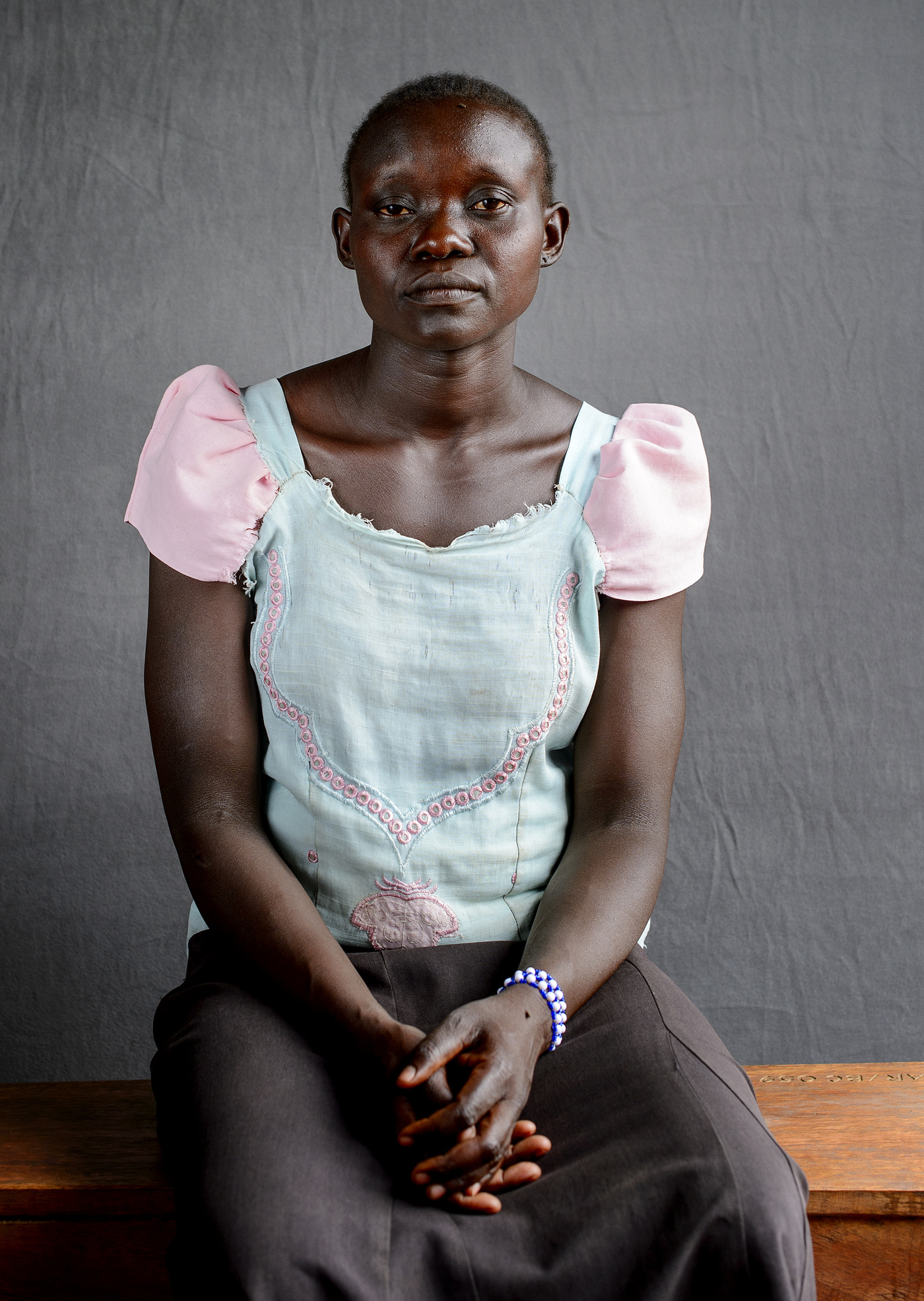 John T. Pedersen Photography - Jane Tabu (26)   My husband was taken in our home at night.     Later I heard that he had been slaughtered      I dont want to return to South Sudan, but to get a safe life here in Uganda.   Jane walked seven days with her two children from the village of Yei.