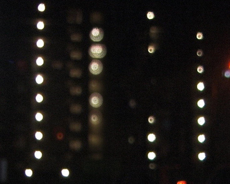 Karolien Chromiak - Lightplay, videostill, 2010 The video shows an anonymous, concrete apartmentbuilding. Focus is on the lights that are shown on every floor. Doing this, a rythmic movement is created and thus a moving image results out of a non-moving object.