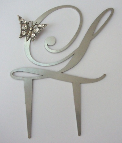 Curvaceous Design Portfolio - Curvaceous Design food grade stainless steel monograms with Swarovski butterfly interest.