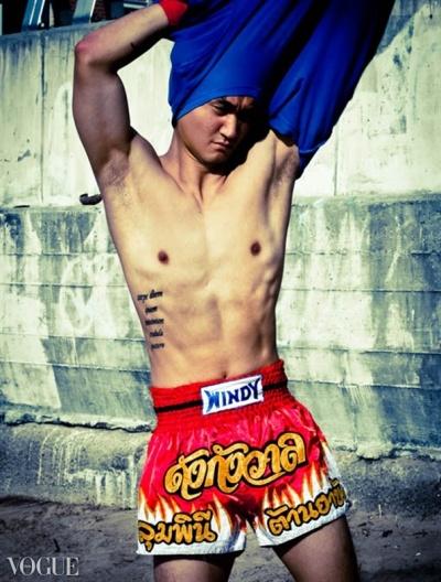 Dilokrit Barose Photos - DK showing off abs.