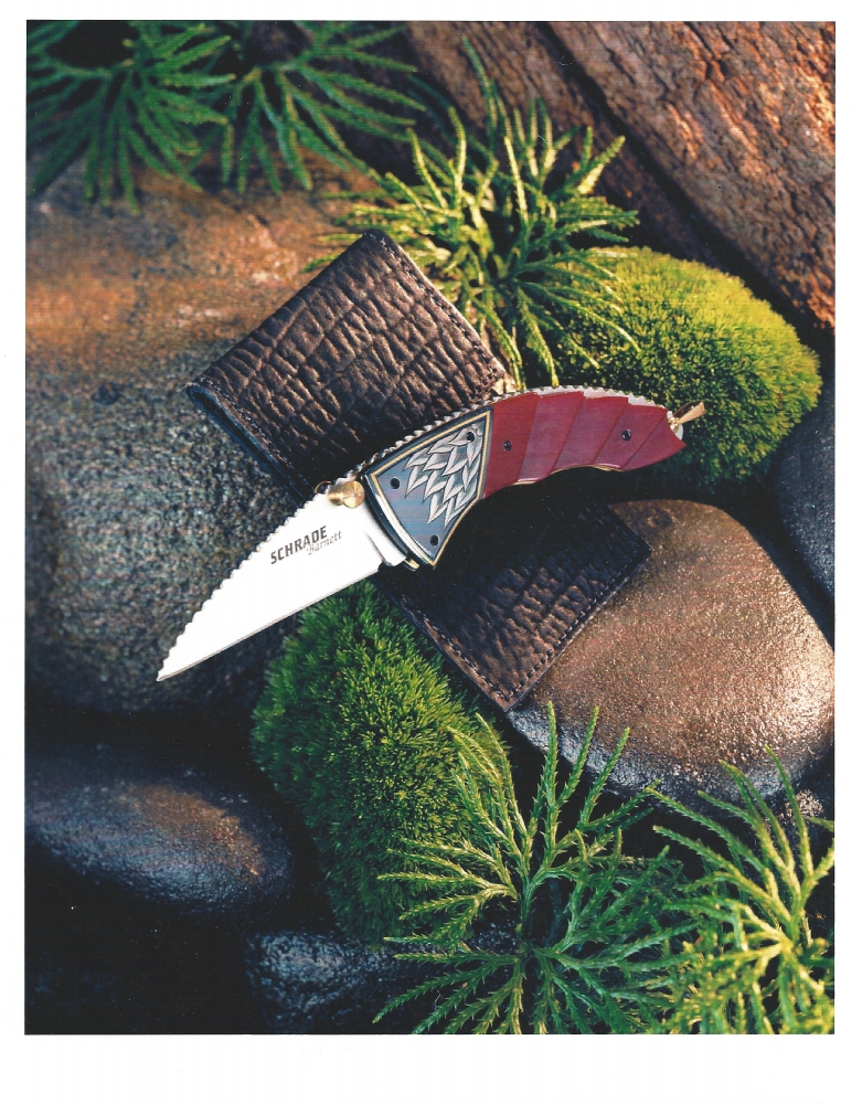 The Art of Van Barnett - Schrade/Barnett - this won Blade Magazines Knife of the Year award for best Factory Collaboration in 2001. Schrade told me it was their only Blade Magazine knife of the year award. Some of the innovative processes that Schrade invented to manufacture this piece with all of its carving and filework, were some of the first in the Factory knife industry at that time. There were two of these knives, one red and one green. There were only 1000 of each and only 500 marked first production run. They are quite valuable on the after-market now. There are about 10 or so that were hand signed by me by engraving my signature on the blades, and also signing all the extra materials, like the leather sheath, zip pouch, box and paperwork. Sadly, a few years after this, Schrade closed after 100 years of producing millions of knives that were sold world wide.