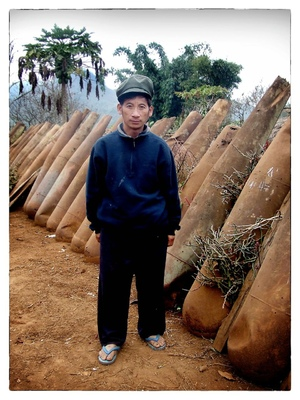 Andrew Bannerman-Bayles - Laotian Villager and American bomb canisters Laos